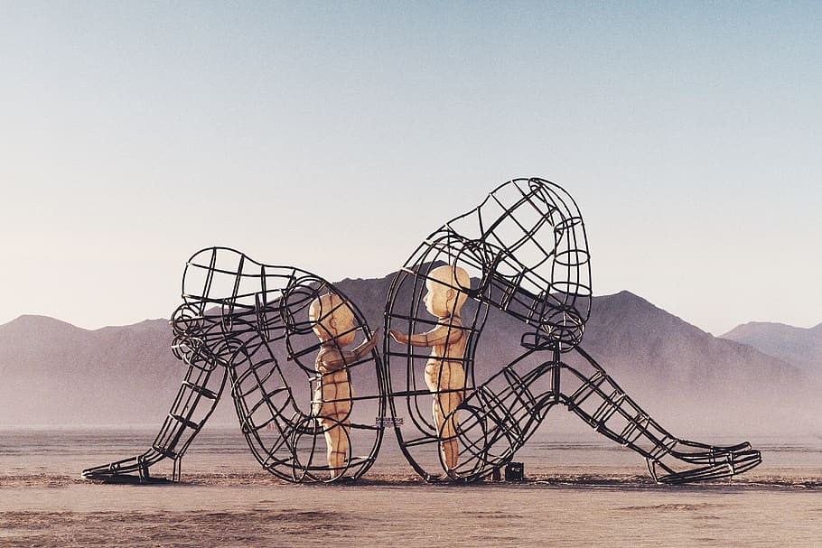 burning man sculpture two wire adults with children inside touching