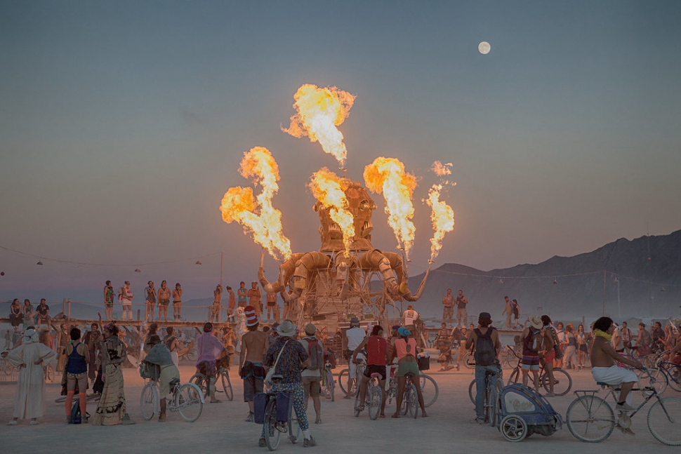 burning man statue of octopus with fire coming out of each tentacle