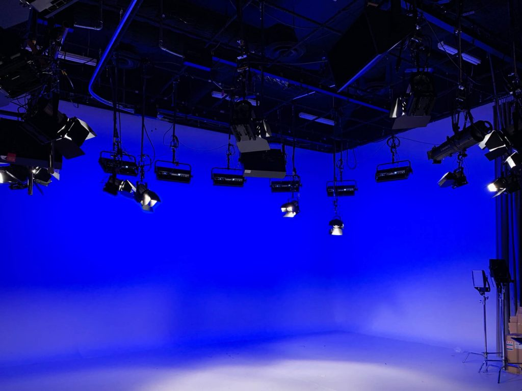 altanta interfaith broadcast studio space lit up in blue