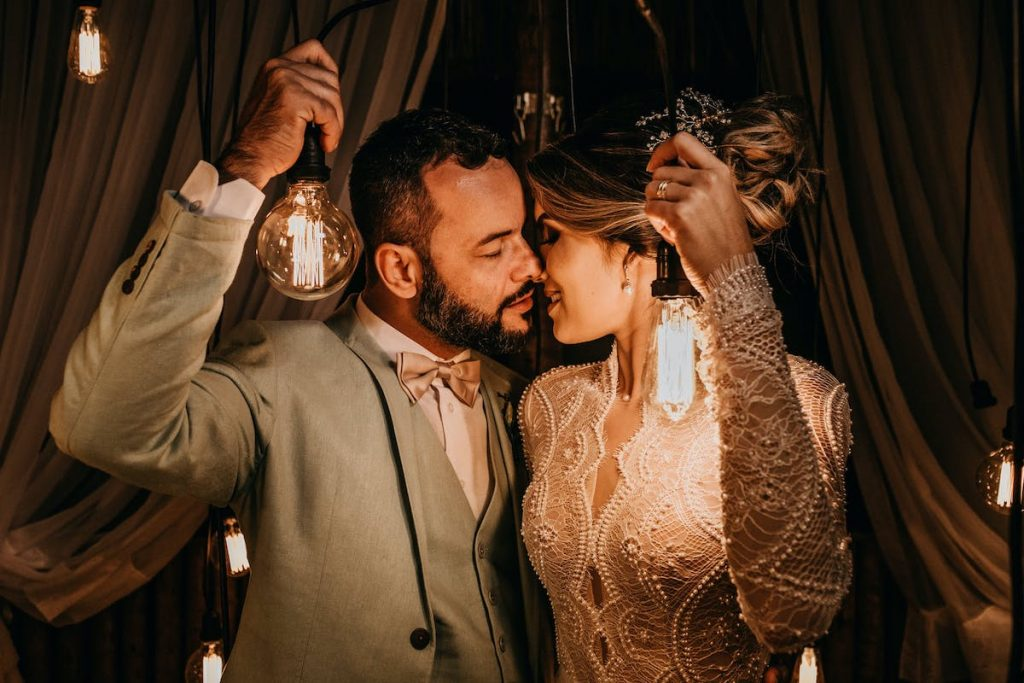 outdoor wedding with couple holding lights