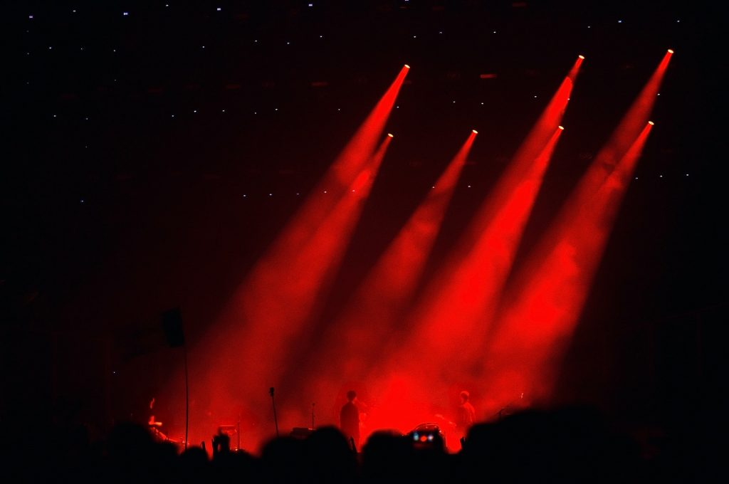 Red stage lights during a live concert