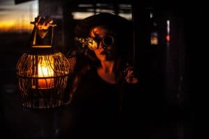 woman holding candle using film lights to make flame