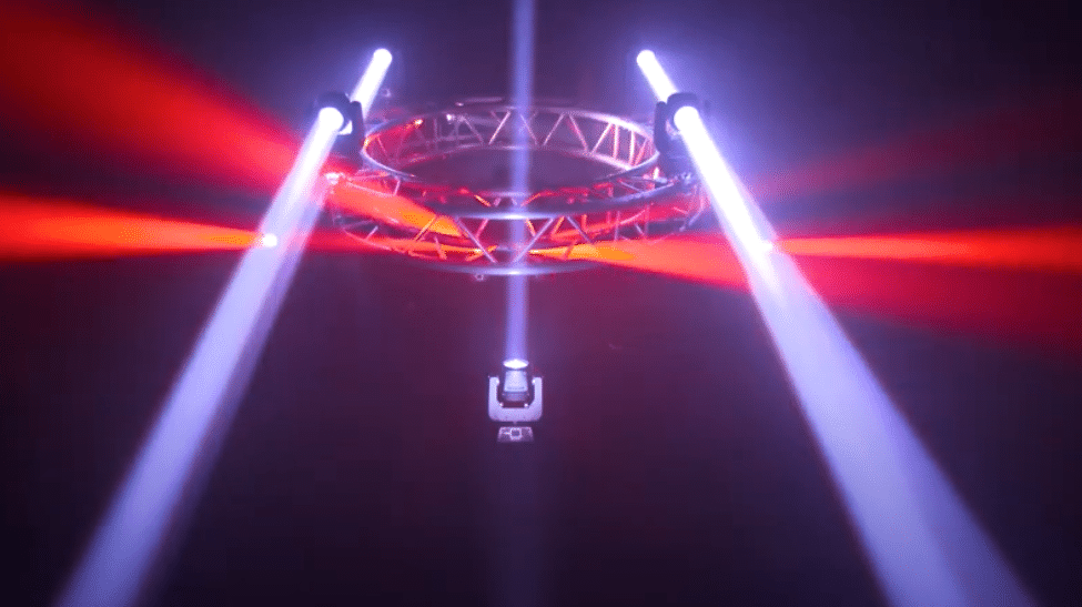 Beam lights on truss shining white and red lights