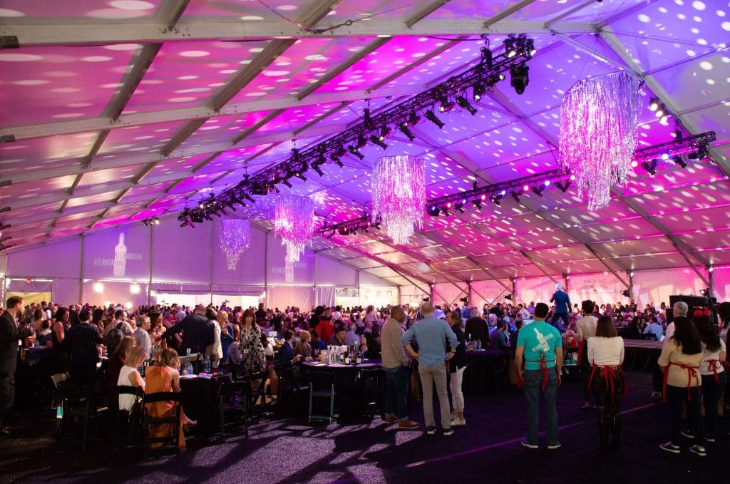 large event in tent with lights on ceiling
